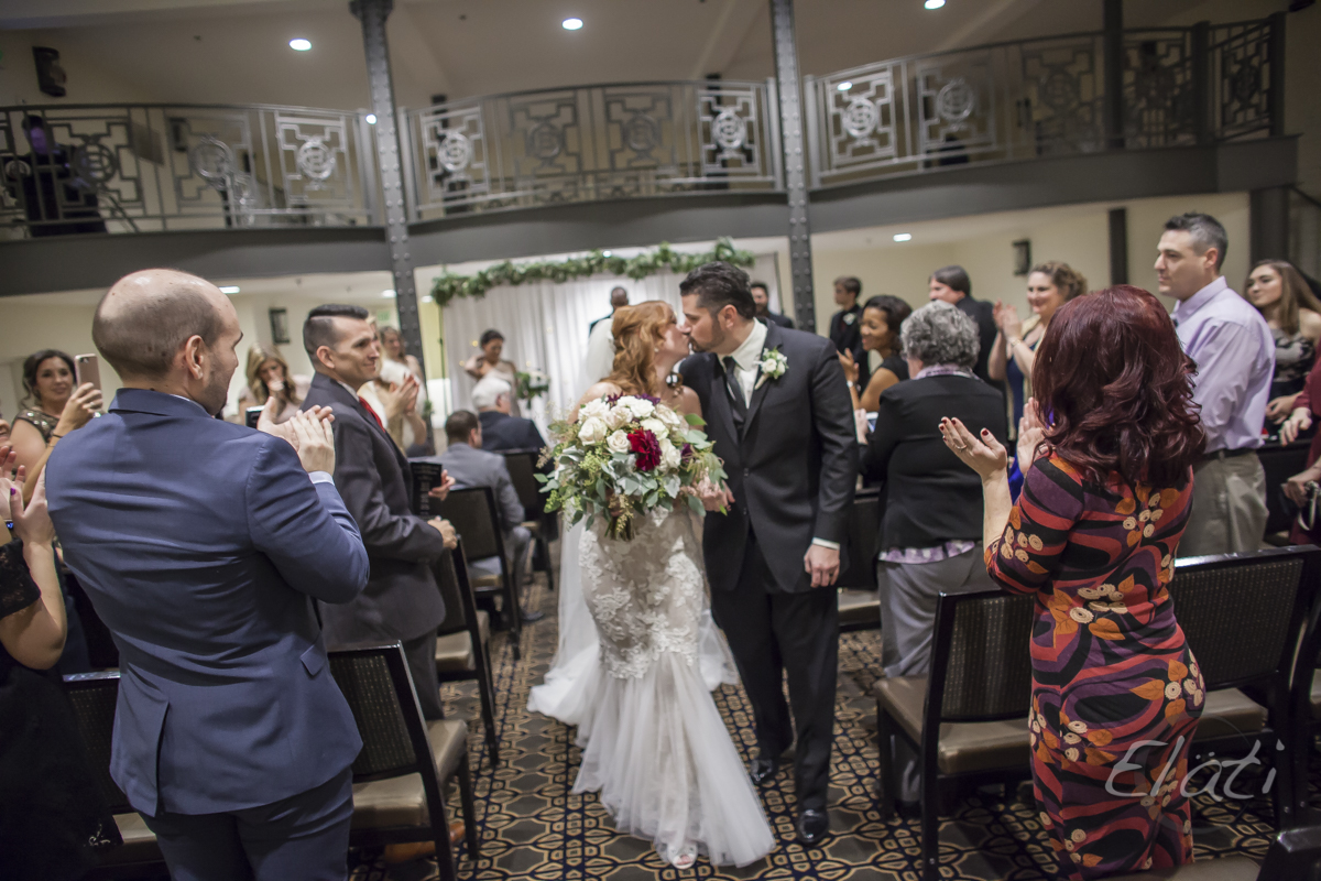 Bride and groom kiss at Oxford hotel wedding